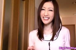breasty oriental milf fondling her bigtits