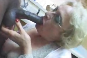very older white lady blows large dark rod in the