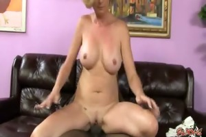 cougar with big tits seduces youthful darksome