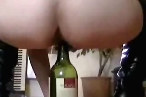 riding a wine bottle on the dinner table