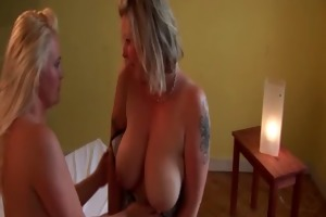 topless aged lesbians giving a kiss sensually in