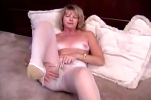 aged blond masturbating in hose and sex tool